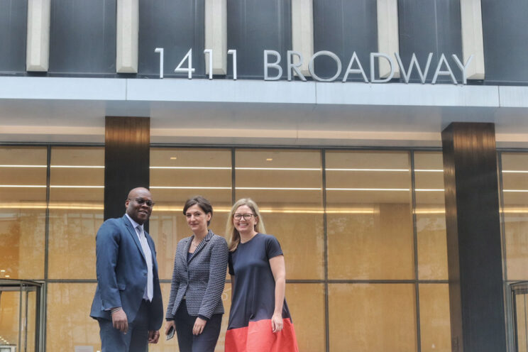 Alex Ford, Ana Meauta and Howard Dilworth outside our New York headquarters | Encompass company news