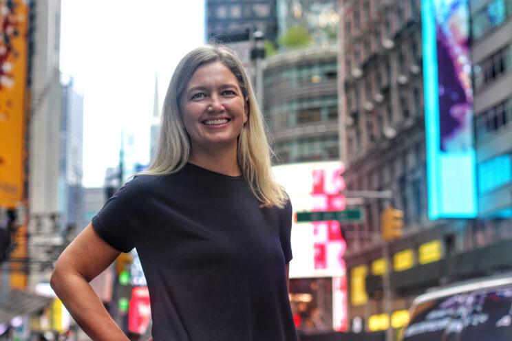 Alex Ford in Time Square at the launch of our New York office | Encompass company news